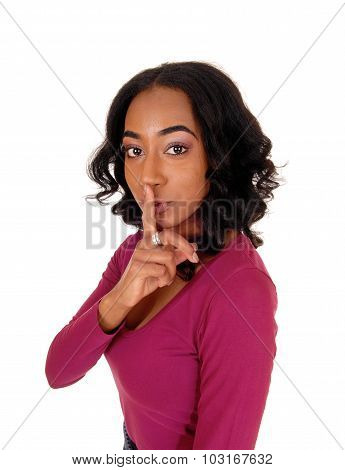 African Woman With Finger Over Mouth.