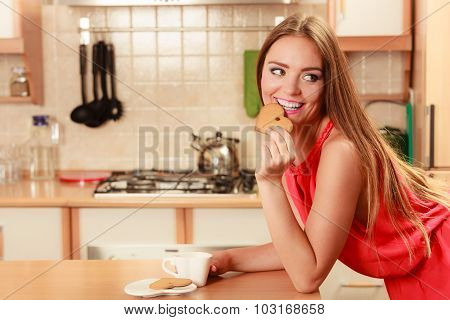 Woman With Tea Coffee Eating Gingerbread Cookie.
