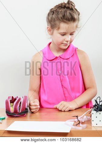 Little Girl Searching For Her Accessories.
