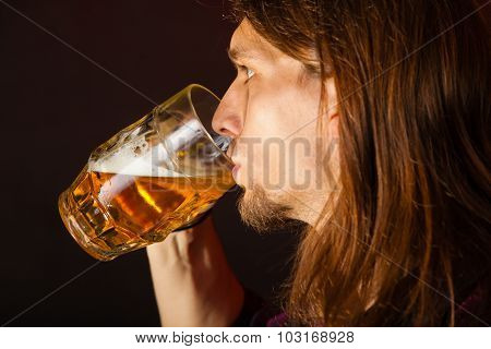 Handsome Young Man Drinking Beer