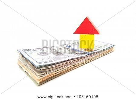 Stylized home on pile of dollar notes. All on white background.