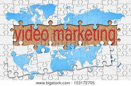 Jigsaw Reveal Video Marketing Word On Cork Background