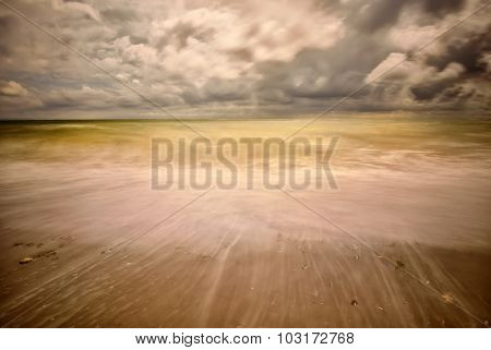 seascape on cloudy summer day - long exposure image