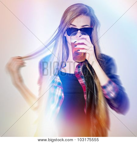 Cool trendy teenage girl drinking beer
