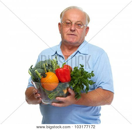 Elderly man with vegetables isolated over white background.