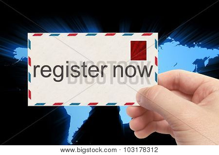Hand Holding Envelope With Register Now Word On World Background