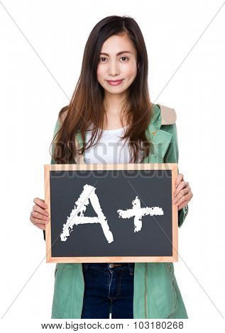 Woman hold with blackboard showing mark A plus