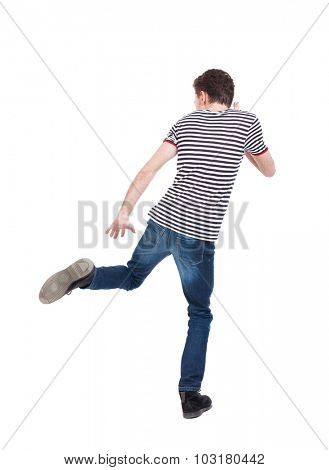 Back view of running man. Walking guy in motion. Rear view people collection. Backside view of person. Isolated over white background. The guy in the striped shirt runs strides.