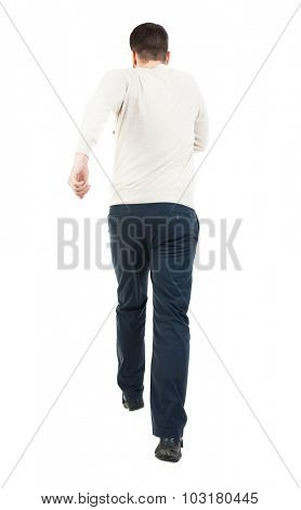 Back view of running man. Walking guy in motion. Rear view people collection. Backside view of person. Isolated over white background. Man escapes strides.