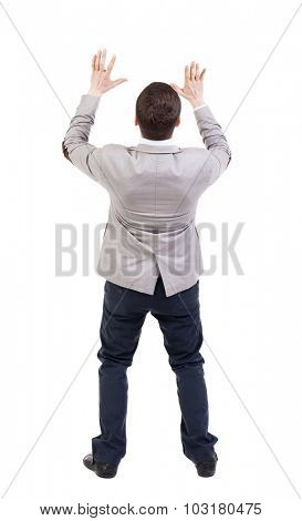 Businessman defends his hands on top of something. backside view of person.  Isolated over white background.