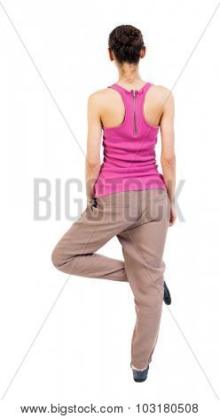 Back view of girl sitting in front of a warm up exercise.  Rear view people collection.  backside view of person.  Isolated over white background. African-American woman standing on one leg doing yoga