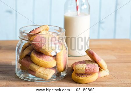 colored butter biscuits in a jar