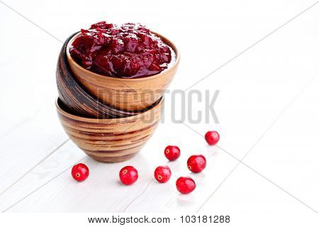 bowl of cranberry sauce - goods in jar