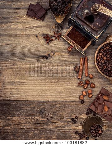 coffee beans and chocolate on a wooden background. top view