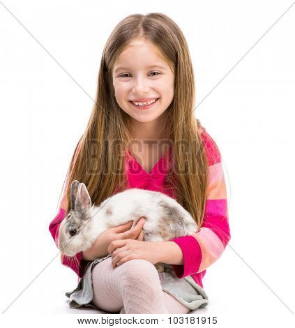 cute smiling girl in a crimson sweater  with baby rabbit over white background close-up
