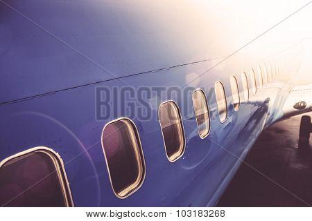 Airplane exterior close up, lens flare