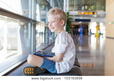 Kid At Airport