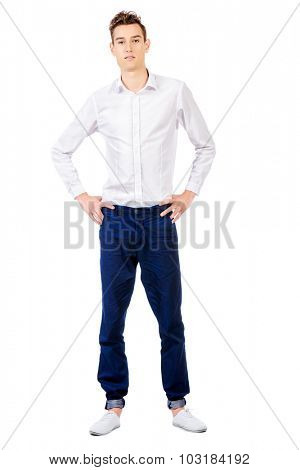 Full length portrait of a handsome young man in white shirt. Studio shot. Isolated over white background.