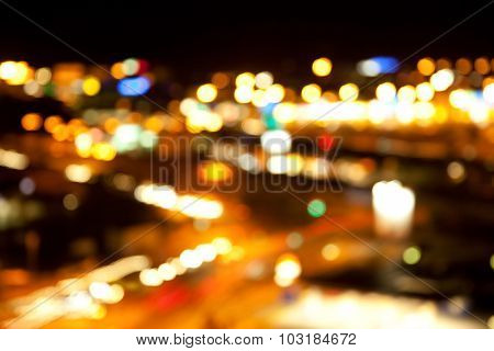 holidays, illumination and electricity concept - golden bright blurred bokeh lights on dark night background