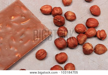 Nutritious Chocolate And Hazelnuts On Cement Structure
