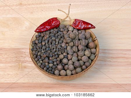 Black Pepper  In A Wooden Bowl