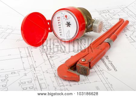 Red water meter with wrench