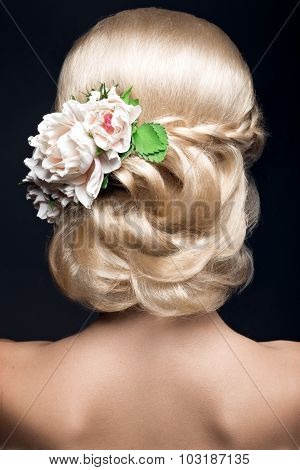 Beautiful blond woman in image of the bride with flowers. Beauty face and Hairstyle  back view