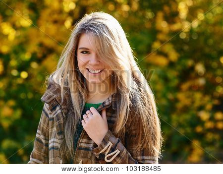 woman smiling in autumn park