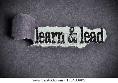 Learn And Lead Word Under Torn Black Sugar Paper