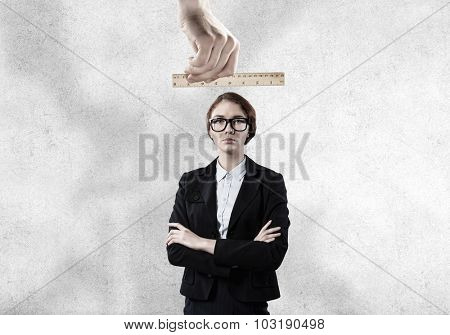 People hands measuring businesswoman with wooden rulers