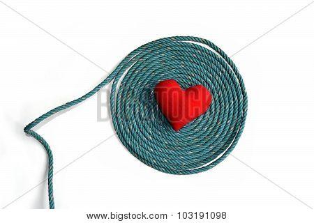 Old green rope and red heart isolate on white background