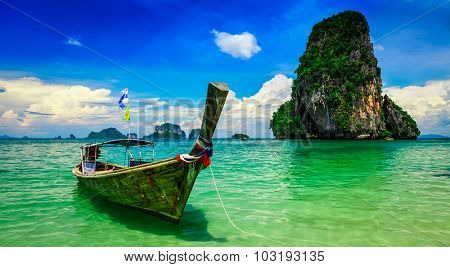 Panorama of long tail boat on tropical beach (Pranang beach) and rock, Krabi, Thailand