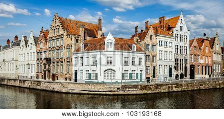 Panorama of Bruges canal and old historic houses of medieval architecture. Brugge, Belgium
