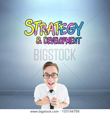 Geeky businessman holding a mug against dark room
