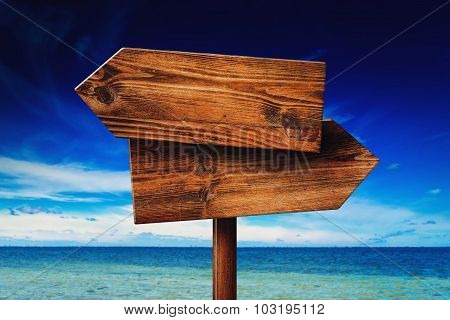 Direction Signpost On Seaside Beach