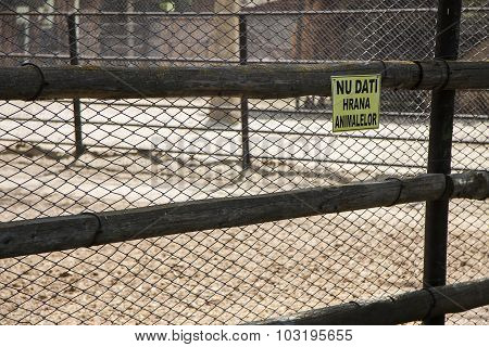 Do Not Feed The Animals Sign On A Fence