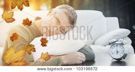 Man resting on cushion against autumn scene