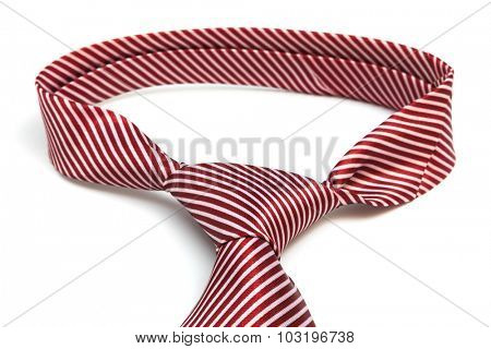 knot red tie on a white background