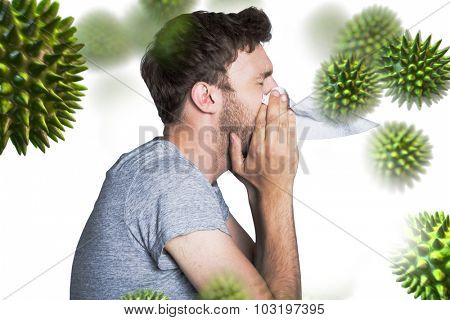 Close up side view of man blowing nose against virus