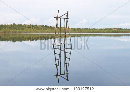 wooden swings over water