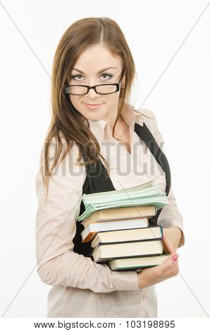 Portrait Of A Teacher With A Heap Of Textbooks And Notebooks