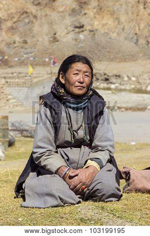 Old Tibetan Woman Uses Her Mala