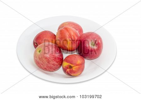 Several Red Apples And Nectarines On A White Dish