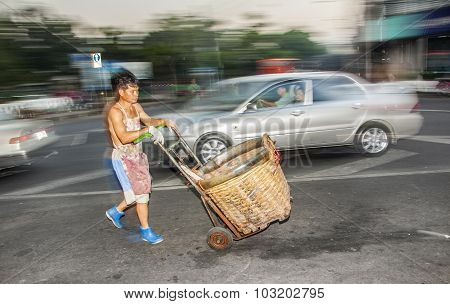 Man Drives Home With Goods On A Barrow From Night Market Pak Khlong Thalat In Bangkok