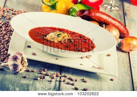 Bean soup - Decorative sausage garlic pepper onion spilled beans.
