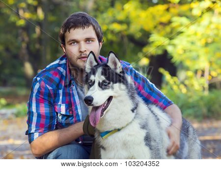 young man and the Siberian Husk
