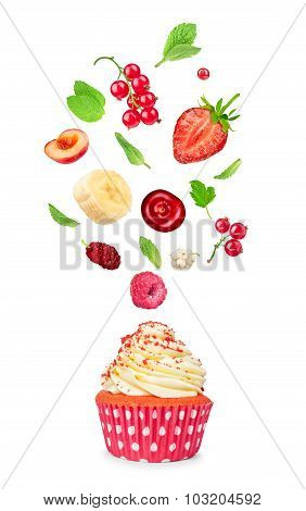 Cupcake With Falling Berries And Mint Isolated On White Background
