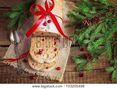 Christmas cake with cranberries on the background of fir branche