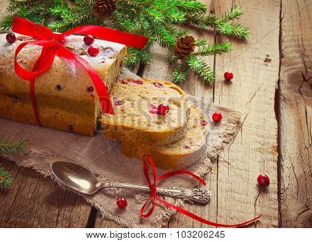 Christmas muffin with fresh cranberries on a wooden background,