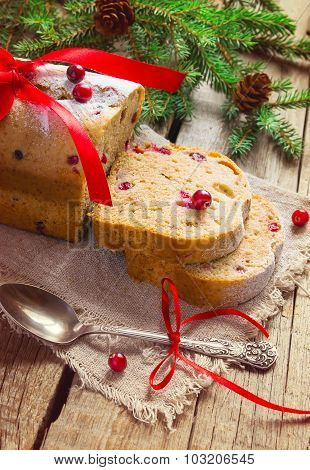 Slices of cake with cranberries. Christmas decoration, image tin